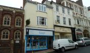 Exeter shop let for Landlord